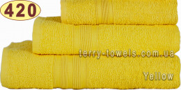 Полотенце 50х90 см желтого цвета 420 г/м2